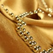 Background of golden fabric — Stock Photo #4612969