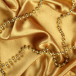 Background of golden fabric — Stock Photo #4613000