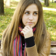 Beautiful young woman sitting on a bench — Stock Photo