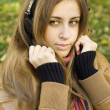 Young woman with headphones in park — Stock Photo