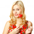 Beautiful young woman with a red heart. — Stock Photo