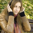 Young woman with headphones in the park — Stock Photo #4685869