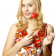 Young woman with a red heart - Foto Stock