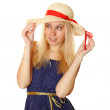 Beautiful young blond woman in a straw hat — Stock Photo