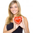 Stock Photo: Smiling Young Woman Holding a Heart