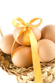 Chicken eggs in the basket — Stock Photo