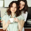 happy couple in their kitchen — Stock Photo