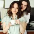 Happy couple in their kitchen — Stock Photo