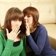 Woman whispers to the girlfriend secrets — Stock Photo #5244053