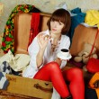 Attractive woman sitting in a suitcase — Stock Photo