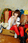 Attractive woman sitting in a suitcase — 图库照片