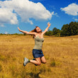 Royalty-Free Stock Photo: Happy young woman in a field
