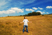 Man standing in a field — Stock Photo