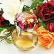 Stock Photo: Perfume and roses