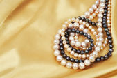 Silk and pearls — Stock Photo