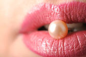 Pearl in pink lips — Stock Photo