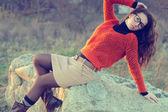 Girl on a rock, fashion woman — Stock Photo