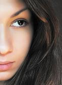 Half face portrait of brunette girl — Stock Photo