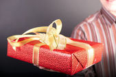 Man holds a gift — Stock Photo