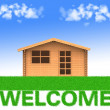 House standing on the words welcome — Stock Photo