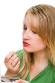 Woman applying lip-gloss with lip brush — Stock Photo