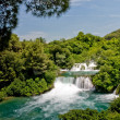 Waterfall in Krka national park in Croatia - Stock Photo