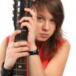 Beautiful woman in red with a guitar - teen rock star — Stock Photo