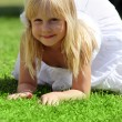 Smiling little girl relaxing outdoor — Stock Photo
