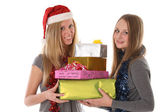 Beautiful young women with gifts for Christmas and New Year - is — Stock Photo