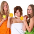 Stock Photo: Beautiful young women with fruit - healthy eating isolated on wh