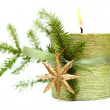 Burn Christmas candle, green ribbon, gold New Year star and spru — Zdjęcie stockowe