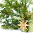 Burn christmas candle, gold decoration and green fir tree - Stock Photo