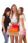 Mujeres jóvenes compras aisladas sobre fondo blanco — Foto de Stock