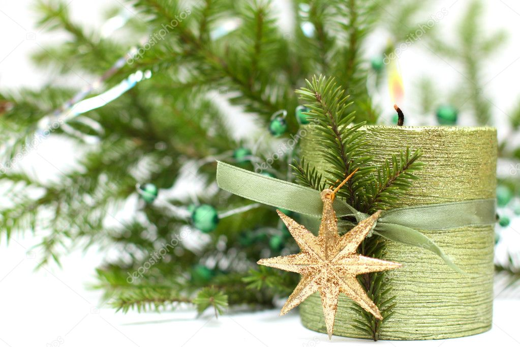 Burn christmas candle, gold decoration and green fir tree — Stock Photo #4162836