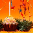 Stock Photo: Christmas background with cupcake, star and candle