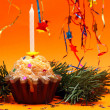 Christmas background with cupcake, star and candle — Stock Photo #4177783