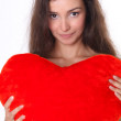 Beautiful female face and red heart close-up — Stock Photo