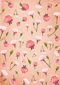 Pink paper background with flowers — Stock Photo