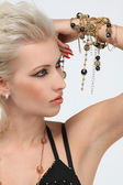 Fashion portrait of professional model with gold jewelry — Stock Photo