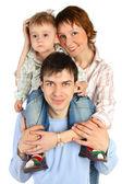 улыбающиеся семьи - мать, отец и ребенок, изолированные на белом — Стоковое фото