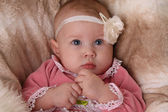 Baby girl with flower headband — Stock Photo