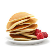 Image of small pancakes topped with berries isolated on white — Stock Photo