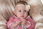Beautiful pensive baby girl — Stock Photo