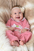 Smiling baby on a beautiful beige background — Stockfoto