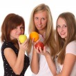 Beautiful young women with fruit - apple and orange fruit — Stock Photo