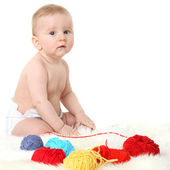 Little baby sitting on a white background — Stock Photo