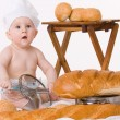 Little baby chef with bread — Stock fotografie