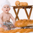 Little baby chef with bread — Stok fotoğraf