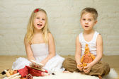 Smiling blond children play with toys — Stock Photo