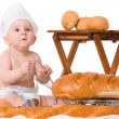 Little baby with bread isolated on white background — ストック写真